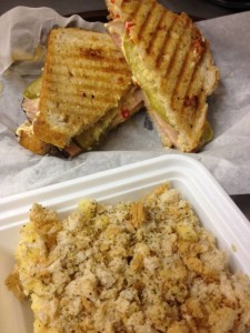 Cubano Panini: Black Forest Ham on Sourdough with sliced dill pickle and our special Pimiento Cheese sauce. Shown with our Gourmet Macaroni and Cheese with herbed bread topping.