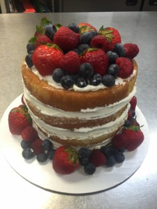 Naked Cake with Whipped Cream Frosting and Fresh Berries