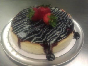 Blueberry-Cheesecake-with-white-chocolate-drizzle-and-fresh-strawberries-300x224